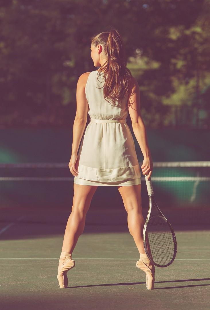 Ballet dancer en pointe with tennis racket<br /> More at <a rel=