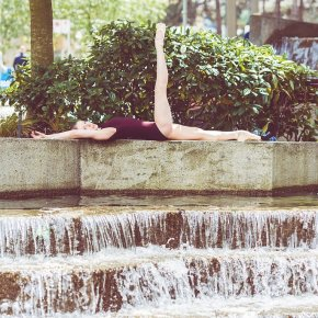 Ballet dancer reclining by fountain